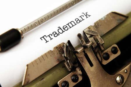 Trademark text on typewriter Standard-Bild