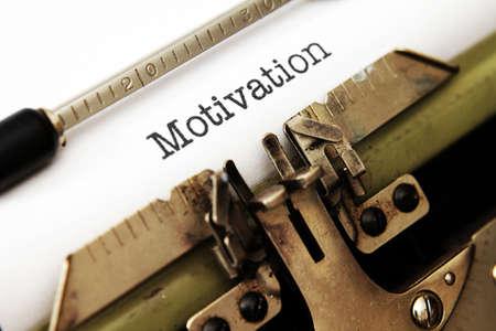 Motivation text on typewriter photo
