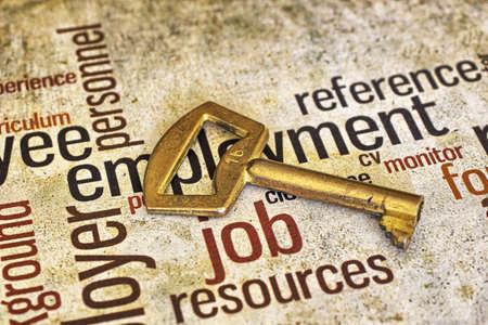 Golden key on job text photo