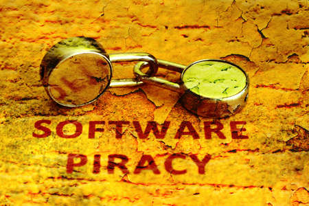 Software piracy grunge concept photo