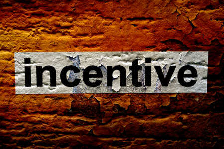 instigation: Incentive text on grunge background Stock Photo