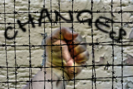 barbwire: Changes and hand against Barbwire Stock Photo