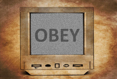 to obey: Obey sign on vintage TV