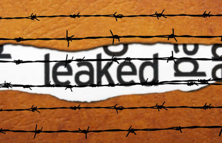 Leaked info and barbwire Stock Photo