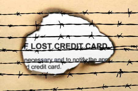 barbwire: Lost credit card nad barbwire Stock Photo