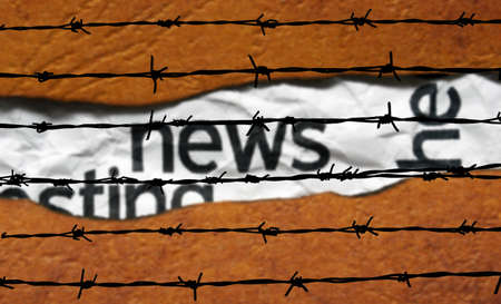 barbwire: News concept and barbwire Stock Photo