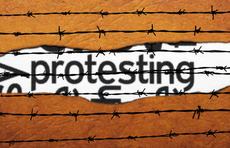 collective bargaining: Protest concept on barbwire Stock Photo