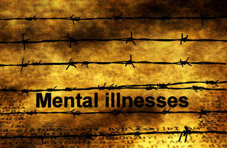 illnesses: Mental illnesses text against barbwire Stock Photo