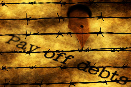 barbwire: Pay of debts text against barbwire