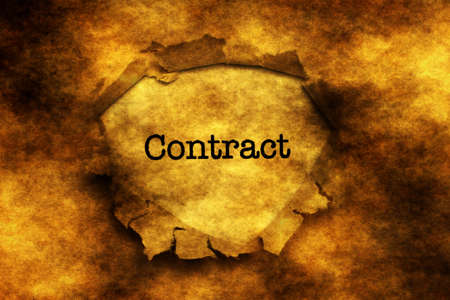 paper hole: Contract text on grunge paper hole