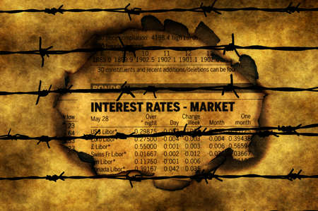 interest rates: Interest rates - market against barbwire Stock Photo