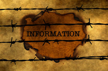 uncovering: Information concept against barbwire Stock Photo