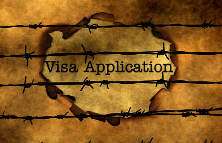 barbwire: Visa application concept against barbwire Stock Photo