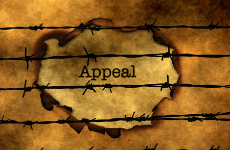 insights: Appeal  text against barbwire Stock Photo