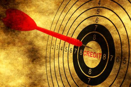 debt goals: Credit target on grunge background