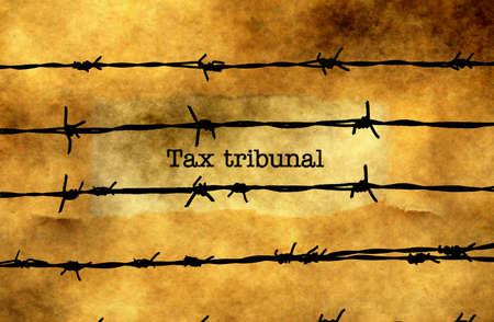 tribunal: Tax tribunal text against barbwire
