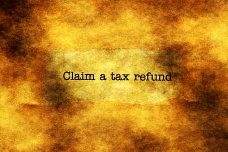 tax refund: Claim tax refund grunge concept Stock Photo