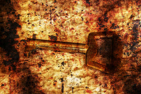 golden key: Old golden key on grunge background Stock Photo