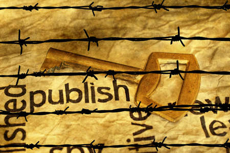 publish: Publish and golden key against barbwire Stock Photo