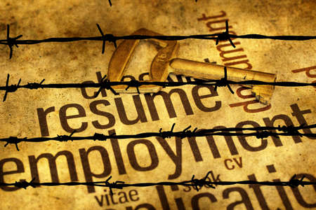 barbwire: Resume and golden key against barbwire Stock Photo
