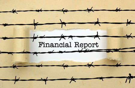 barbwire: Financial report text against barbwire Stock Photo