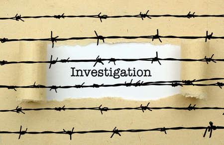 investigacion: Texto Investigaci�n contra el alambre de p�as Foto de archivo