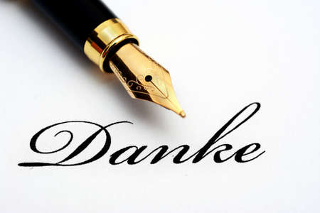 germanic: Fountain pen on danke text - A word of Germanic origin, meaning thanksthank you; Stock Photo