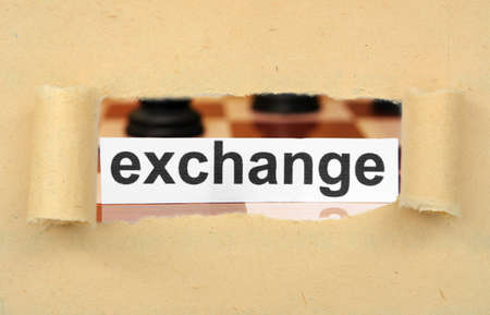 corporate espionage: Exchange tag on ripped paper