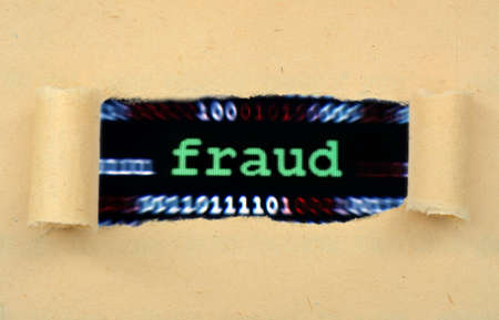 web scam: Fraud text on ripped paper