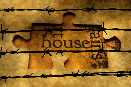 barbwire: House puzzle concept against barbwire