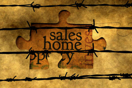 barbwire: Sales home puzzle concept against barbwire Stock Photo