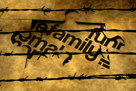 barbwire: Family puzzle concept against barbwire Stock Photo