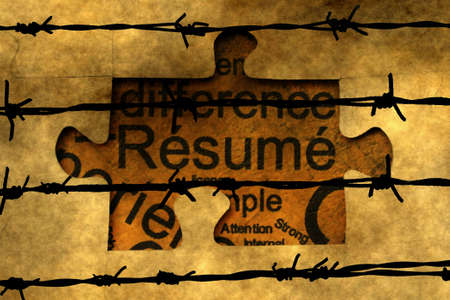 barbwire: Resume puzzle concept against barbwire Stock Photo