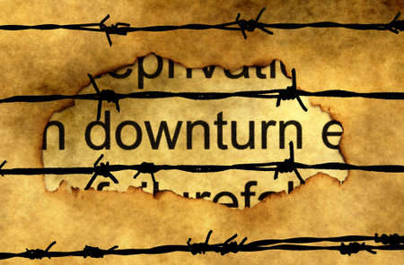 downturn: Downturn text on paper hole against barbwire Stock Photo