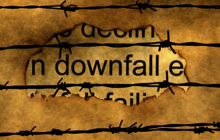 downfall: Downfall text on paper hole against barbwire