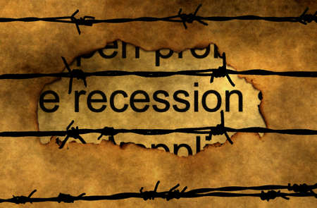 burning money: Recession text on paper hole against barbwire