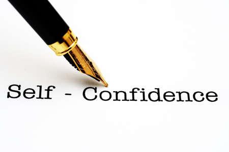 confianza: Auto confianza de texto y pluma Foto de archivo