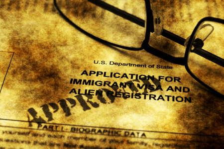 immigrant: Immigrant visa form grunge concept