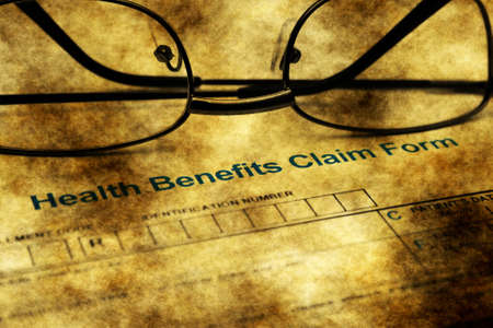 hmo: Health benefits claim form grunge concept Stock Photo