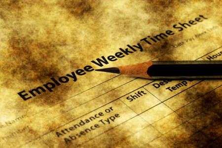 timekeeping: Employee time sheet grunge concept