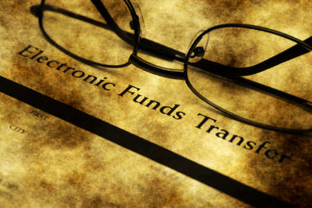 funds: Electronic funds transfer grunge concept Stock Photo