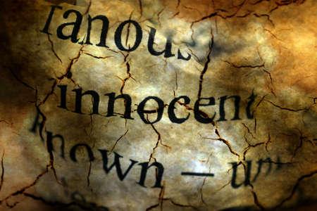 innocent: Innocent text on grunge background Stock Photo