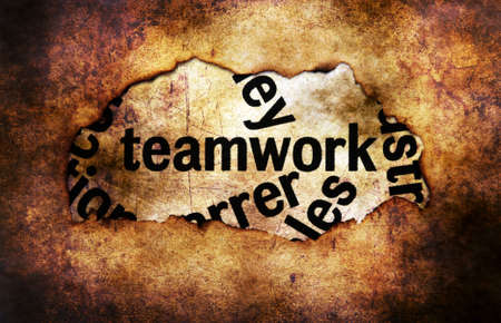 paper hole: Teamwork text on paper hole grunge concept Stock Photo