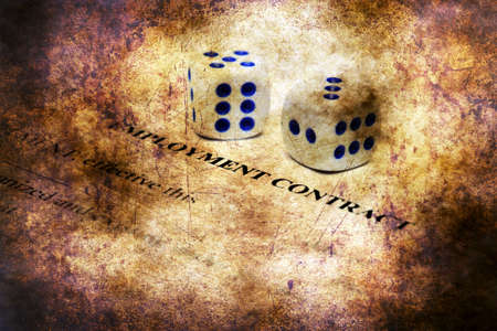 stipulation: Employment contract and dice on grunge concept Stock Photo