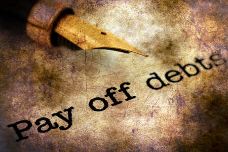 escalating: FOuntain pen on pay off debts text