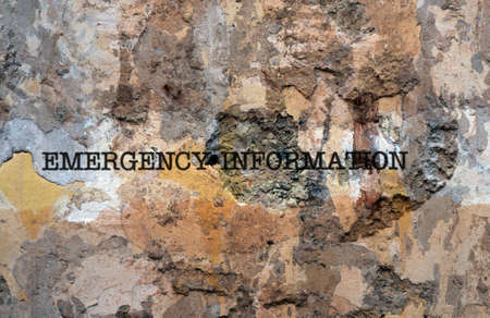 flee: Emergency information text on wall Stock Photo