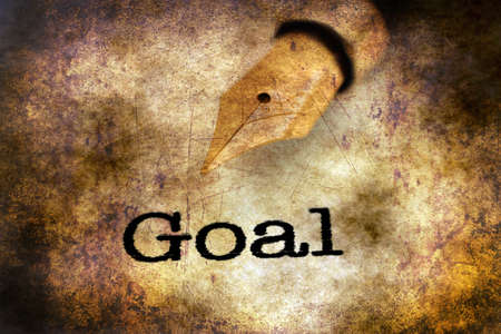 note pad and pen: Fountain pen on goal text grunge concept Stock Photo