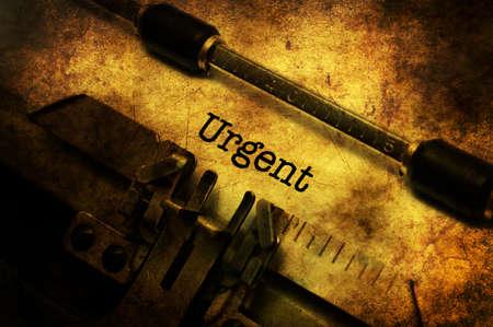 Urgent text on vintage typewriter Stock Photo