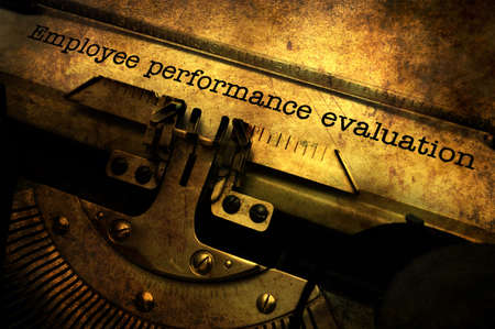 Employee performance evaluation on typewriter Stock Photo