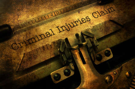 Criminal injuries claim grunge concept Stock Photo